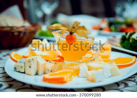 Cheese of different varieties on a plate. Restaurant - stock photo
