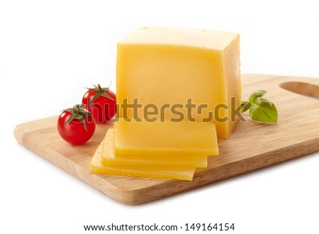 Cheese on cutting board - stock photo