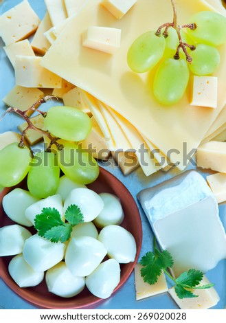 cheese on metal tray and on a table - stock photo