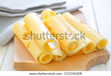 cheese on wooden board - stock photo