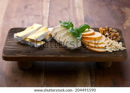 cheese on wooden platter - stock photo