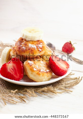 Cheese pancakes with fruit and sweets