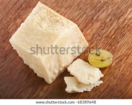 cheese parmesan on wooden board - stock photo