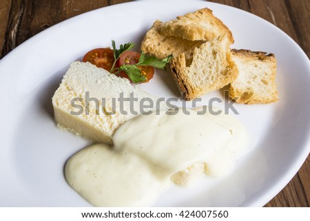 Cheese pate with toasted bread and cheese sauce - stock photo