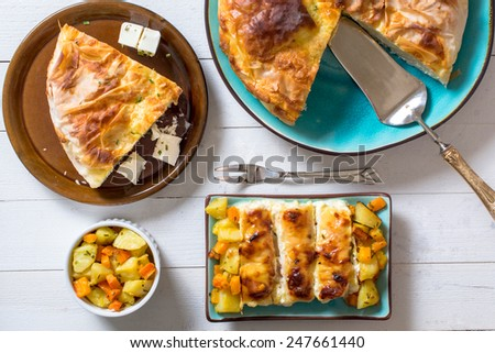 Cheese pie and stuffed chicken meat stuffed with ham and cheese  - stock photo