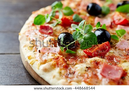 Cheese pizza with cherry tomatoes and ham - stock photo