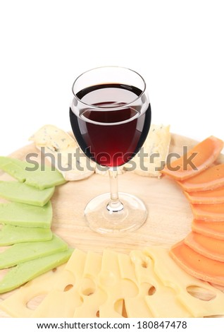 Cheese plate and glass of wine. Isolated on a white background.
