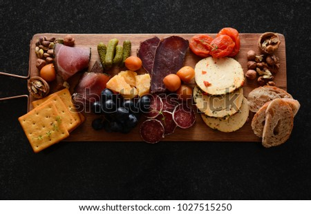 Cheese plate on a board. A different cheese with meat. Snack jamon prosciutto & Cheese Plate On Board Different Cheese Stock Photo u0026 Image (Royalty ...