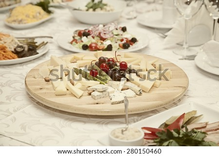 Cheese plate on the festive table - stock photo