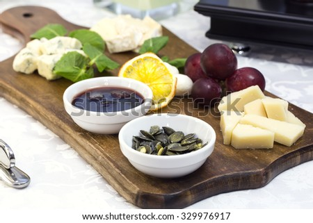 cheese plate with a large decorated the assortment of mint