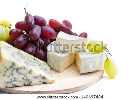 Cheese plate with grape - stock photo