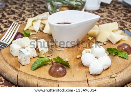 cheese plate with several varieties of cheese in the restaurant