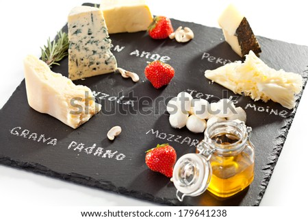 Cheese Plate with Strawberries, Nuts and Honey - stock photo