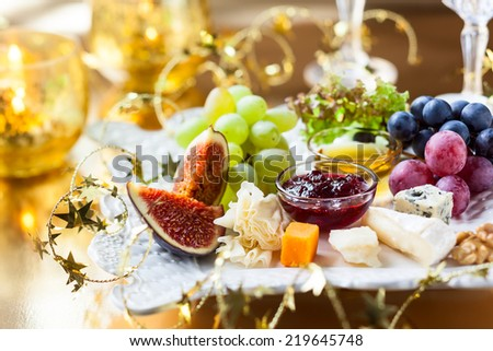 Cheese platter for Christmas - stock photo