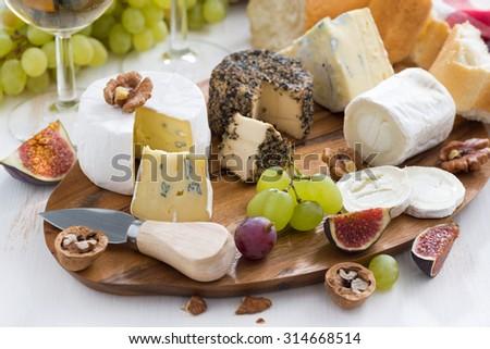 cheese platter, snacks and wine, close-up, horizontal - stock photo