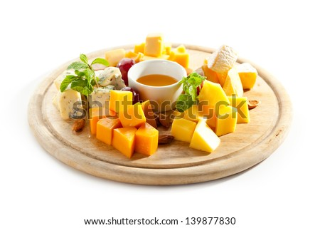 Cheese Platter with Grapes and Honey - stock photo