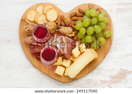 cheese platter with red wine - stock photo