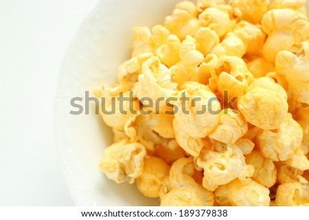 Cheese popcorn on white bowl from high angle view - stock photo