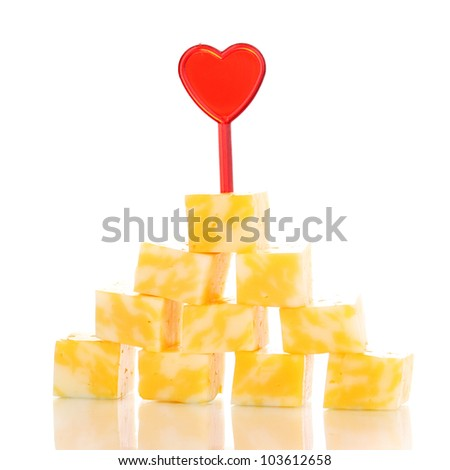Cheese pyramid isolated on white - stock photo