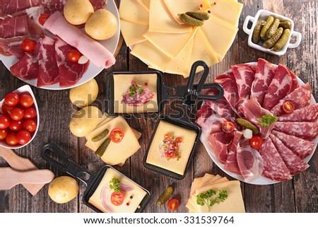 cheese raclette party - stock photo