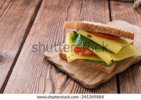 Cheese Sandwich (close-up shot) on vintage wooden background - stock photo