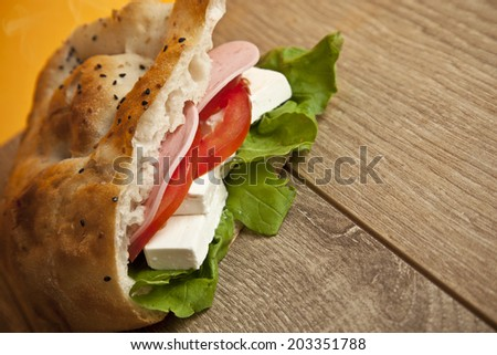Cheese sandwich with tomato, cucumber and salad - stock photo