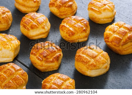 cheese scones on black wood table