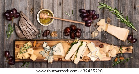 Cheese Selection On Wooden Rustic Board Platter With Different Cheeses Grapes Nuts