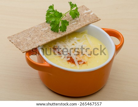 Cheese soup with crutoons and fresh herbs