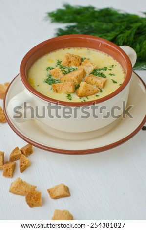 cheese soup with herbs and croutons