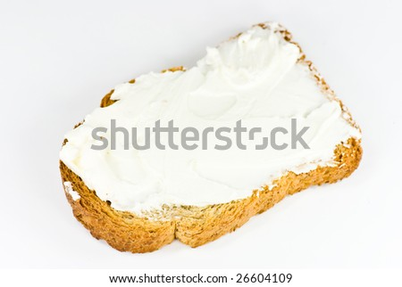 cheese spread on bread on white background - stock photo
