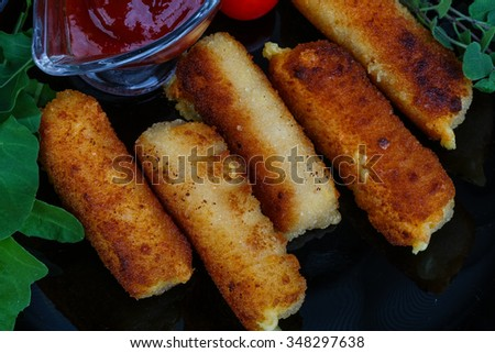 Cheese sticks with sauce served fresh rucola leaves - stock photo