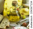cheese still life with olive oil - stock photo