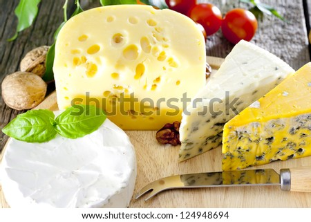 Cheese various assortment on wooden boards - stock photo