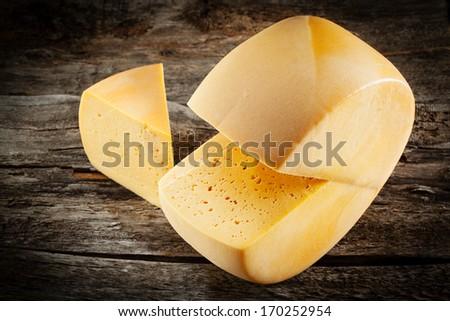 Cheese wheel on wood. Organic food - stock photo