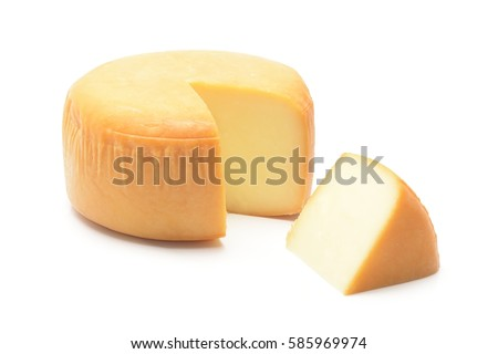 Cheese wheel with a piece of cheese on a white background