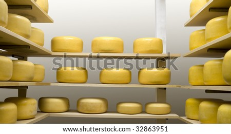 Cheese Wheels Maturing in an Aging Room - stock photo