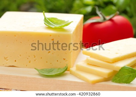 Cheese with basil and vegetables - stock photo