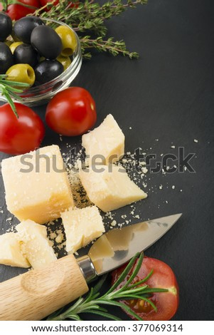 cheese with fresh herbs, black and green olives, cherry tomatoes, selective focus - stock photo