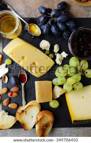cheese with fruits and toasts, top view