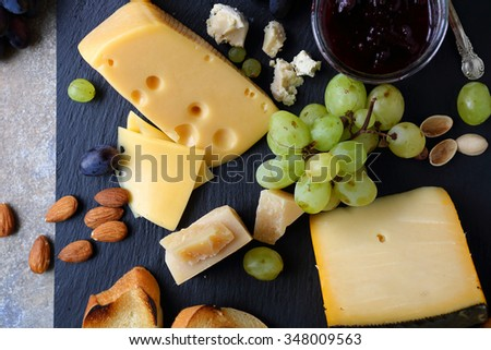 cheese with grapes, food top view