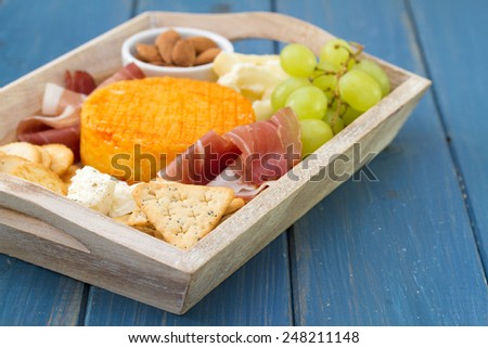 cheese with grapes, toasts - stock photo