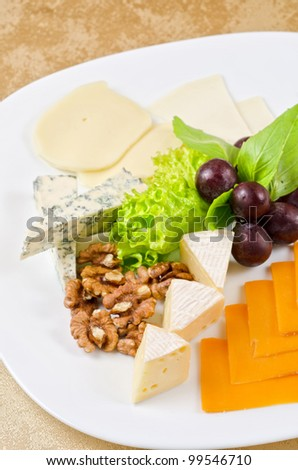 cheese with lettuce, grapes and nuts