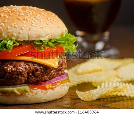 Cheeseburger and Chips - stock photo