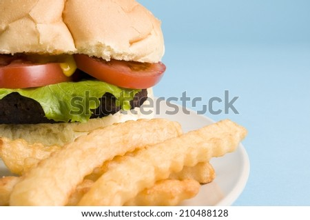 Cheeseburger with a side of crinkle-cut fries
