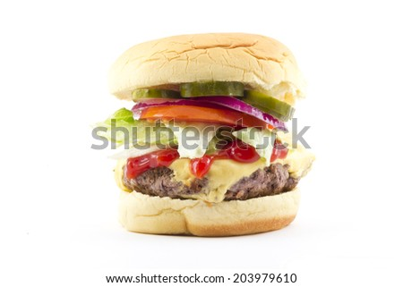 Cheeseburger with all the toppings isolated on white - stock photo