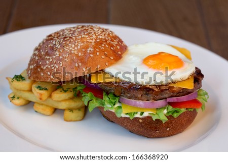 cheeseburger with eggs - stock photo