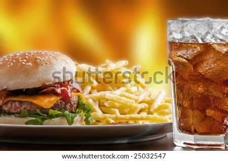 Cheeseburger with fries and icy soft drink - stock photo