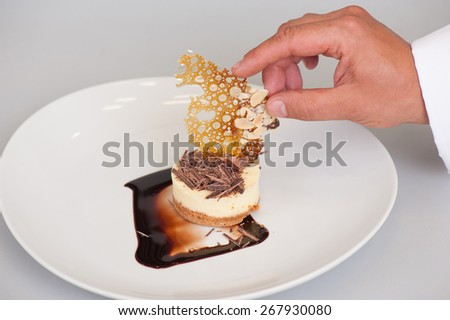 cheesecake and caramel and chocolate pieces - stock photo
