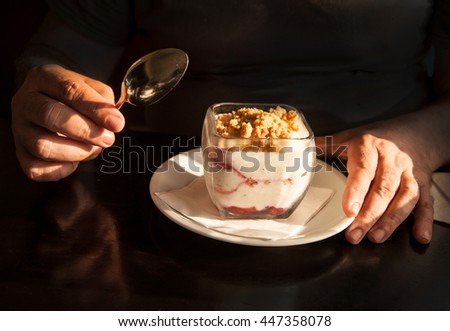 cheesecake in glass on black background  - stock photo